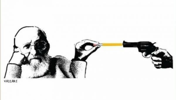 Paulo Freire mit Stift in die Pistole